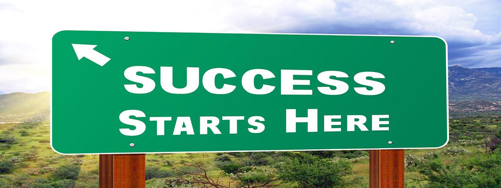 Success Starts Here Freeway Sign
